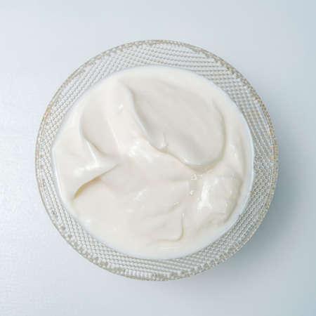 Photo Top view sour cream against white background. Closeup. Foto de archivo