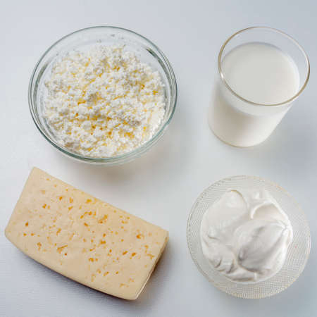 Top view Photo still life with dairy products cottage cheese, sour cream and yogurt on a white background
