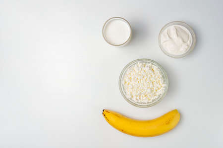 Photo Smiley with banana and dairy products. Healthy food concept.
