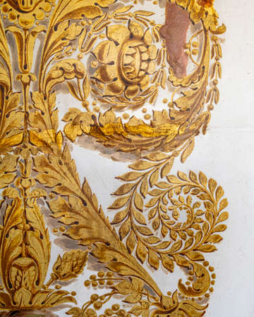 Photo element woodcarving. furniture in classic style. white tree with gold trim. patina. carving. small depth of field. luxury furniture.