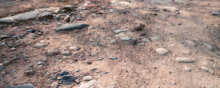 Banner Top view unpaved road surface, stones and sand.