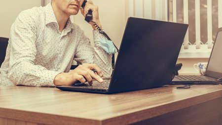 Photo businessman using his laptop, close up. Office work. Foto de archivo