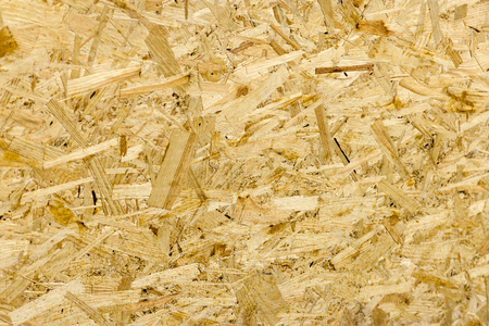 Pressed wooden panel background seamless texture of oriented strand board - OSB