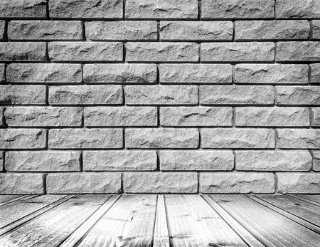 brick floor: empty white room interior with brick wall and wood floor Stock Photo