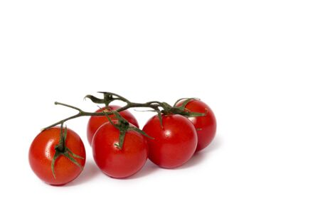 light and shadow: Closeup of tomatoes on white background with light shadow
