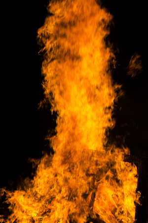 hellfire: Fire flames on a black background. Blaze fire flame texture background. Close up of fire flames isolated on black background.