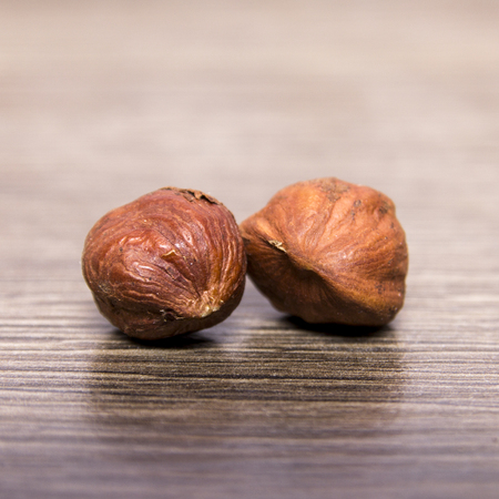 matting: handful of hazelnuts on a wooden background Stock Photo