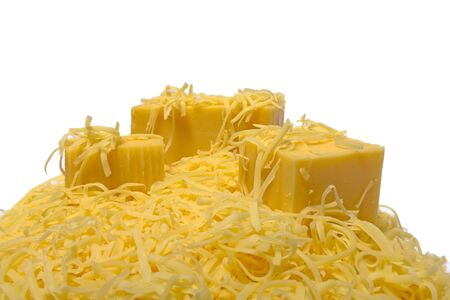 grated and chunks of hard cheese on a white background
