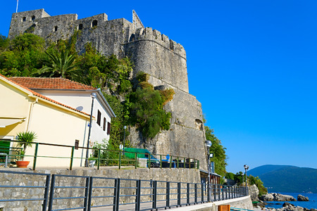 kotor: Old fortress of Kotor, Montenegro. Tower and wall, mountain at the background