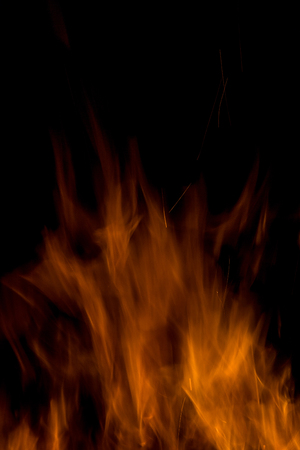 gas fireplace: Fire flames on a black background. Blaze fire flame texture background. Close up of fire flames isolated on black background. Burn. Abstract fire flames background. Texture.