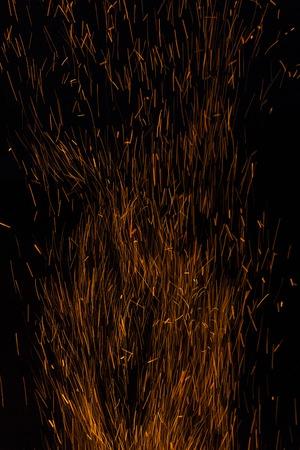 bonfire spark in the dark sky in night
