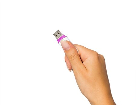 electronic background: hand of a girl with a flash drive