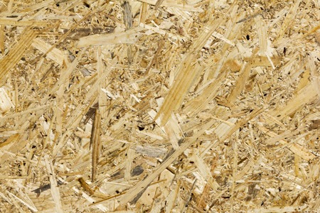 OSB boards are made of brown wood chips