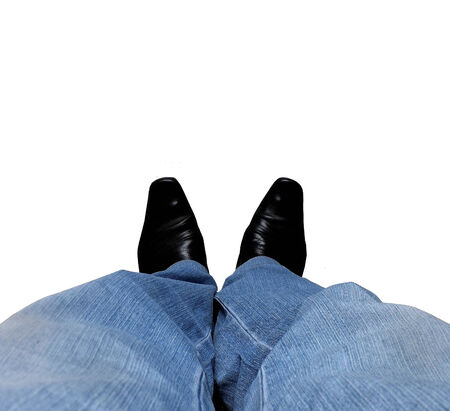 Feet of the man in jeans on a white background photo