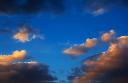 ominous: Contrasting ominous clouds on the background of azure sky