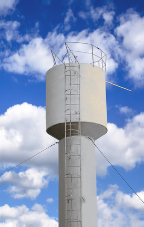 thin shell: Light metal water tower on a background of the cloudy sky