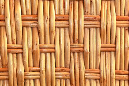 wicker work: Simple wicker wooden background made of twigs closeup