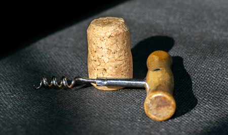 Corkscrew and cork on a contrasting background of fabric Stock Photo