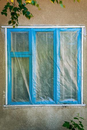 polyethylene film: Blue window of the building under the polyethylene film