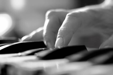 pianist: Stylized hand of pianist  in motion close-up in black and white Stock Photo