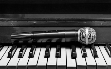 Black and white pianos and wireless microphone