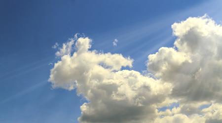 Cumulus clouds in the sun against the blue sky