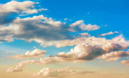 Mysterious beautiful clouds with a golden hue