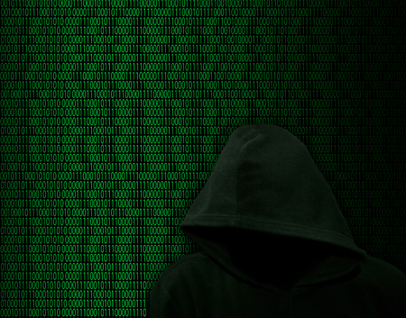 Unknown in the hood on a background of binary digits
