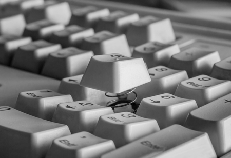 Part of a computer keyboard with a raised button close-up Archivio Fotografico - 126202432