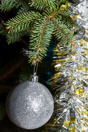 Spruce branch with ball and tinsel close up Archivio Fotografico - 126202441