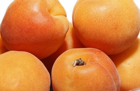 Several ripe large juicy apricots close up Stok Fotoğraf - 132051119