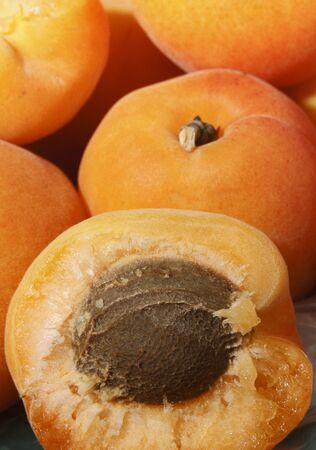 Several ripe large juicy apricots close up Stock Photo
