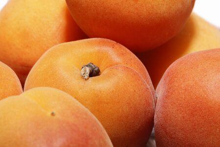 Several ripe large juicy apricots close up Stok Fotoğraf - 132051073