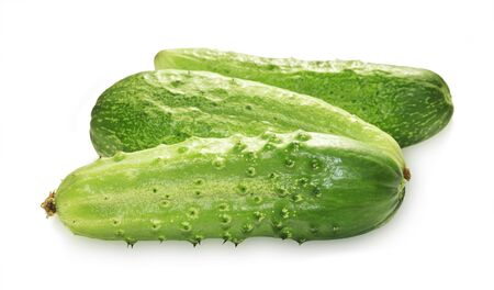 Three green cucumbers isolated on white background Stock Photo