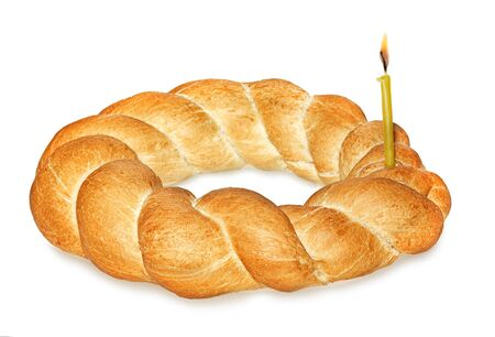 Wicker bread and burning candle isolated on white background