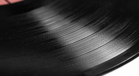 Part of phonograph records on white background close up