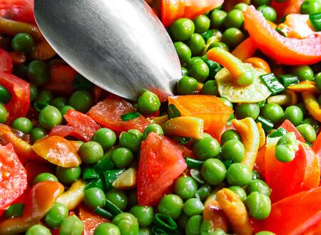 Tomato salad with mushrooms and green peas close-up