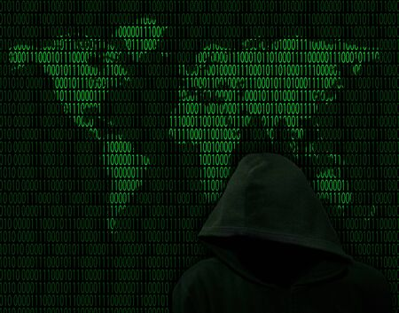 Unknown in the hood against the background of the world map of binary digits