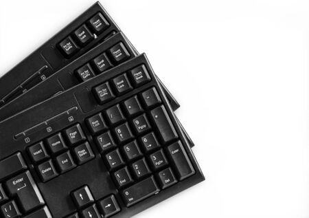 Three computer keyboards isolated on white background Stock fotó