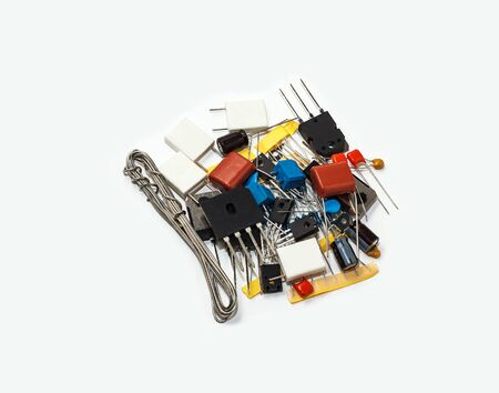 A handful of electronic components isolated on white background