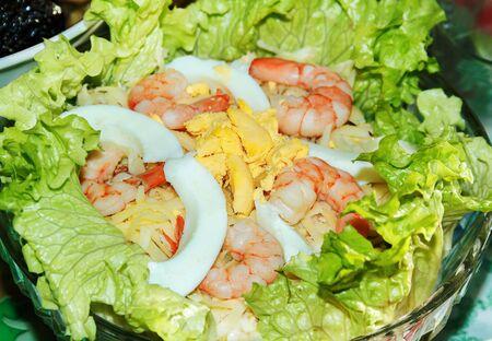 Shrimp salad with boiled egg garnished with lettuce