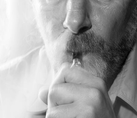 Black-white portrait of a smoking man on a light background