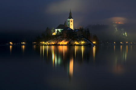 Foggy evening on Bled lake in Slovenia photo