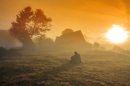 Foggy morning sunrise landscape in Transylvania photo