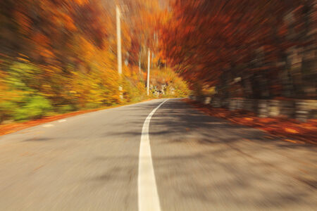 Autumn motion blurred road in Transylvania photo