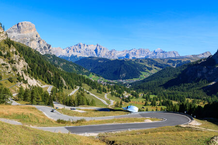 Mountain road in the valley of the Dolomites, Italy photo
