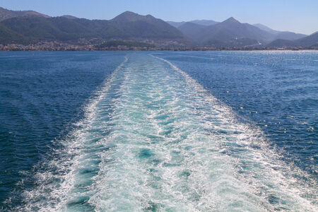 Waves at sea the boat after in Greece photo