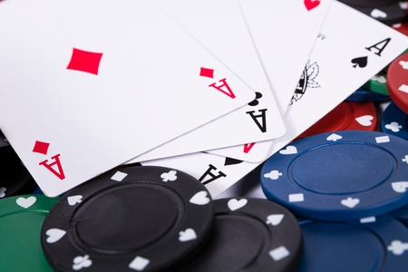 poker chip: Poker chips and cards on white background