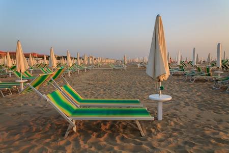 sunbeds: Sunbeds on the beach in Rimini, Italy