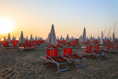 sunbeds: At sunrise sunbeds on the beach in Rimini, Italy Stock Photo